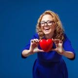 Funny woman holding heart shape Stock Photo
