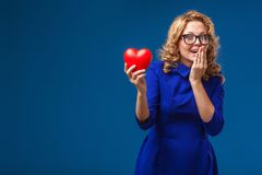 Funny woman holding heart shape Royalty Free Stock Photography