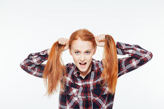 Funny woman holding her ponytails Royalty Free Stock Photo