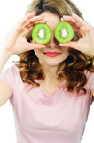 Young woman holding kiwi fruit for her eyes Stock Images