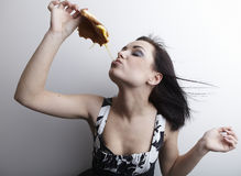 Funny woman holding a sandwich Royalty Free Stock Image