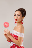 Funny Woman Holding Two Red Lollipops. Pin-up Stock Photography