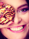 Funny woman holds cake in hand covering her eye Royalty Free Stock Photography