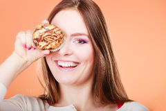 Funny woman holds cake in hand covering her eye Royalty Free Stock Photo