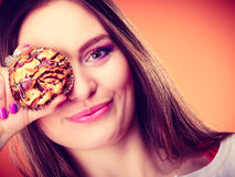 Funny woman holds cake in hand covering her eye Stock Photo