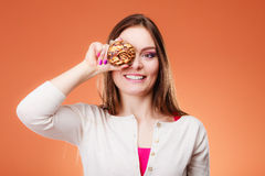 Funny woman holds cake in hand covering her eye Stock Images