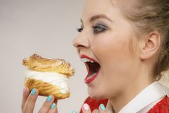 Funny woman holds cream puff cake stock images