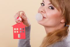 Funny woman holds house keys eat chewing gum Stock Image
