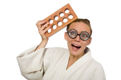 The funny woman in kimono with brick on white. Funny woman in kimono with brick on white Stock Photography