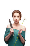 Funny woman with knife and flower Stock Photography