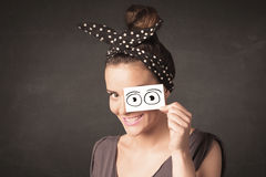 Funny woman looking with hand drawn paper eyes Stock Photo