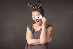 Funny woman looking with hand drawn paper eyes Stock Images
