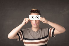Funny woman looking with hand drawn paper eyes Stock Photos