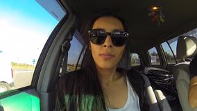 Funny Woman Making Selfie With GoPro Inside the Car Journey stock footage