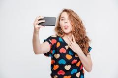 Funny woman making selfie photo on smartpone Stock Photo