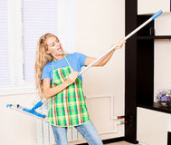 Funny woman with mop Stock Image