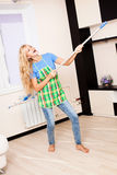 Funny woman with mop Royalty Free Stock Photo