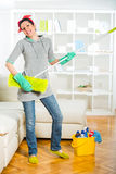 Funny woman mopping floor and singing. Woman mopping floor and singing Royalty Free Stock Image