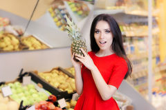 Funny Woman with Pineapple Fruit in Supermarket Royalty Free Stock Photography
