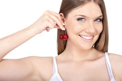 Funny  woman playing with cherries. Funny young woman playing with cherries, isolated on white background Royalty Free Stock Photography