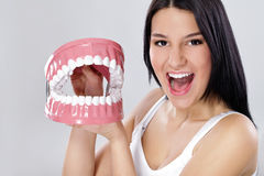 Funny woman playing with jaws. Young girl playing with jaws, concept- healthy teeth royalty free stock image