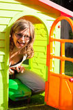 Funny woman playing in playhouse Royalty Free Stock Image