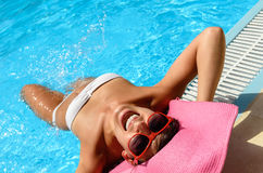 Funny woman in pool Stock Photo