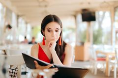 Funny Woman Reading Restaurant Menu stock image