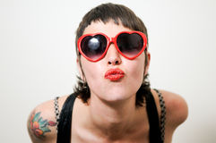 Funny woman with red heart sunglasses Royalty Free Stock Images