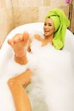 Funny woman relaxing in bath looking at the camera Stock Image
