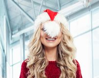 Funny woman in santa hat smiling, Christmas and New Year party. Portrait royalty free stock photo