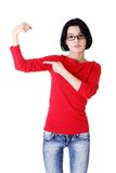 Funny woman showing her muscles Stock Images