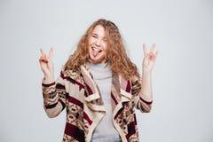 Funny woman showing tongue at camera Stock Photo