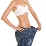 Funny woman shows her weight loss Royalty Free Stock Images