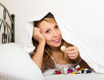 Funny woman smiling with chocolate candy Stock Photos