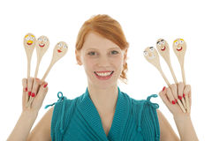 Funny woman with spoons Royalty Free Stock Photos