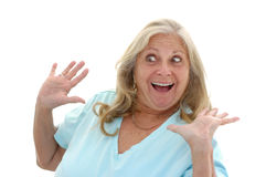 Funny Woman Surprised. Woman in her late fifties with a funny surprised expression photographed on a white background Royalty Free Stock Photography