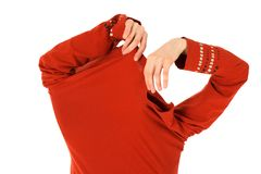 Funny woman takes off an orange shirt royalty free stock photography