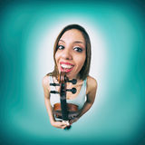 Funny woman with violin Royalty Free Stock Photography