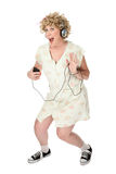 Funny woman waving with music player Stock Photos