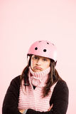 Funny woman wearing Cycling Helmet portrait pink background real definition Stock Photos