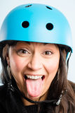 Funny woman wearing cycling helmet portrait real people high definition Stock Image