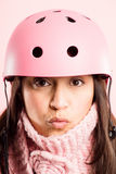 Funny woman wearing Cycling Helmet portrait pink background real definition Royalty Free Stock Image