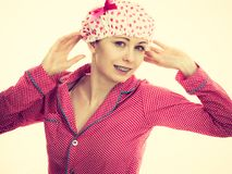 Funny woman wearing pajamas and bathing cap Stock Image