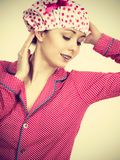 Funny woman wearing pajamas and bathing cap Stock Photography
