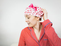 Funny woman wearing pajamas and bathing cap Royalty Free Stock Photography