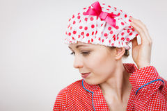 Funny woman wearing pajamas and bathing cap Stock Images