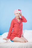Funny woman wearing pajamas and bathing cap Stock Image