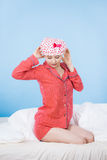 Funny woman wearing pajamas and bathing cap Royalty Free Stock Images
