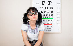 Funny woman wearing spectacles in an office at the doctor Royalty Free Stock Image